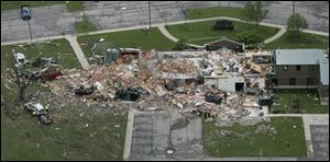 The Lake Township administration building in Wood County was reduced to rubble by the tornado, which also destroyed Lake High School. More than 100 buildings were destroyed in the area.