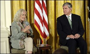 Actress Glenn Close, left, sitting next to National Association of Broadcasters President Gordon Smith, right, speaks about her family's struggles with mental illness.