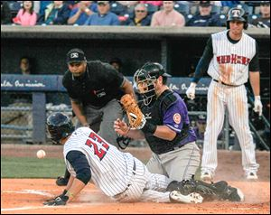 Toledo's Nick Castellanos scores as Louisville catcher Konrad Schmidt drops the throw in the sixth inning.