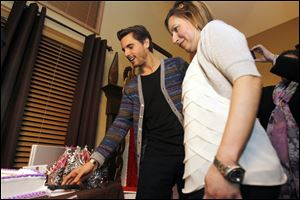 Scott Disick, left, and Josie Langsdorf, right, a Monclova Township woman with terminal cancer, cuts a cake with Disick's picture on it on January 15, 2013.