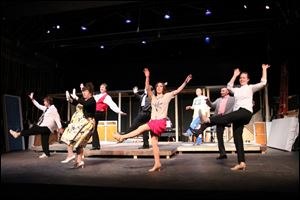 The cast members of 'The Drowsy Chaperone' kick up their heels in a dance number from the production that opens this weekend at the Toledo Repertoire Theatre, 16 10th St.