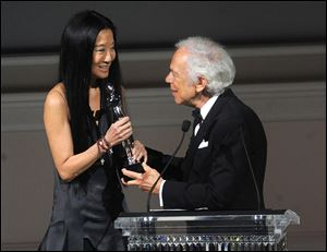 Designer Vera Wang, left, is presented with an award by fellow designer Ralph Lauren at  the 2013 CFDA Fashion Awards at Alice Tully Hall on Monday in New York.