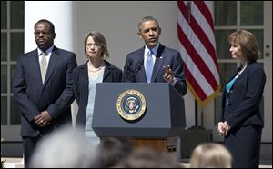 President Obama speaks announced the nominations of, from left, Robert Wilkins, Cornelia Pillard, and Patricia Ann Millet, to the U.S. Court of Appeals for the District of Columbia Circuit today in the Rose Garden at the White House.