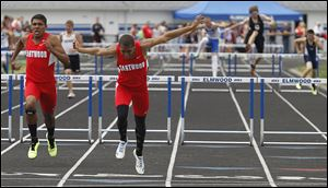 Eastwood's Joey Salinas, left, and Devin Snowden race in the 300-meter hurdles at the Northern Buckeye Conference meet. Snowden won the event at the Division II regional and ran on two winning relays.