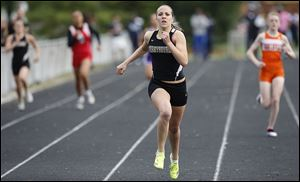 Perrysburg senior Emily Wyrick wins the 400 meters at the Northern Lakes League meet. She won the 800 at the Division I regional and will run at state on a 3200 relay team, which has the top qualifying time.