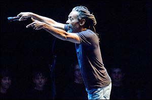 Vocalist Bobby McFerrin uses audience participation during a live concert.