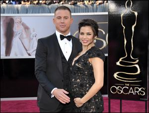 Channing Tatum and his then pregnant wife, Jenna Dewan-Tatum, stop on the red carpet at the 85th Academy Awards.