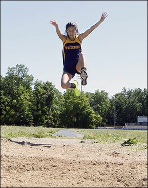 Whiteford junior Miranda Johnson set a Michigan Division 4 state meet record at 18 feet, 2½ inches to defend her championship in the long jump. She also won the 200 meters in 25.94 seconds and finished runner-up in the 100 (12.86).