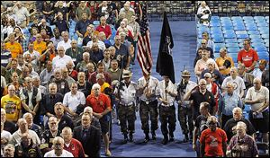 The Vietnam Veterans of America Chapter 35 Honor Guard presents the Colors during the Vietnam Era Veterans Appreciation event at Savage Arena at the University of Toledo.
