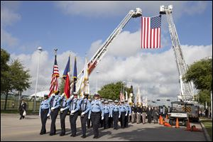 Firefighter's from around Houston and Texas walk during the firefighter's memorial procession today into Reliant Stadium.  As many as 40,000 people are expected to remember the four firefighters who died Friday
