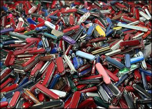 John Pistole, the head of the Transportation Security Administration (TSA) says he's dropping a proposal that would have let airline passengers carry small knives, souvenir bats, golf clubs and other sports equipment onto planes