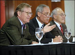 OSU President Gordon Gee, left, explains his decision to retire as board Chairman Robert Schottenstein, center, and Provost Joseph Alutto listen Wednesday.