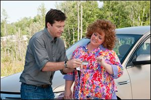 Jason Bateman and Melissa McCarthy in a scene from the comedy 'Identity Thief.'
