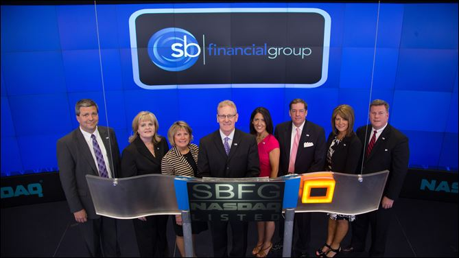 Mark A. Klein, president and CEO of SB Financial Group, presides over the NASDAQ stock market closing bell. Shown at the closing bell are, from left, Jon Gathman, senior lender; Keeta Diller, director of operations; Pam Benedict, residential real estate manager; Mr. Klein; Nichole Wichman, market and sales strategist; Tony Cosentino, executive vice president and CFO; Kristen Nusbaum, chief retail/deposit officer; and Craig Kuhlman, executive vice president, wealth management.