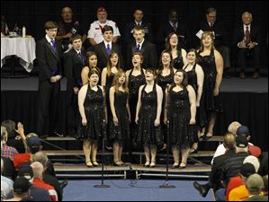The Maumee High School Select Singers perform.