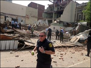 Emergency personnel respond to a building collapse on the edge of downtown Philadelphia on June 5.