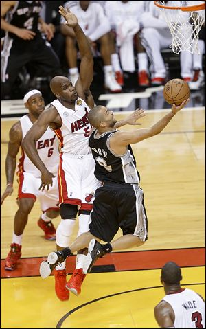 San Antonio point guard Tony Parker scored 21 points and added six assists as the Spurs drove past the Heat in Game 1 of the NBA Finals on Thursday night in Miami.