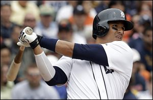 Detroit Tigers' Victor Martinez hits a two-run home run against the Tampa Bay Rays in the fourth inning in Detroit today.