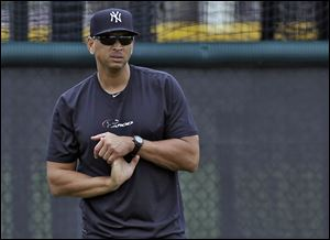 New York Yankees third baseman Alex Rodriguez stretches his wrist during a workout at the Yankees' minor league complex in Tampa, Fla., Wednesday.