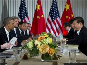 President Barack Obama sits across the table from Chinese President Xi Jinping at the Annenberg Retreat at Sunnylands as they meet for talks.