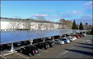 The solar canopy in the Toledo Museum of Art parking lot is in addition to panels on the roof. Along with energy-efficiency measures, they helped the museum create excess power two days.