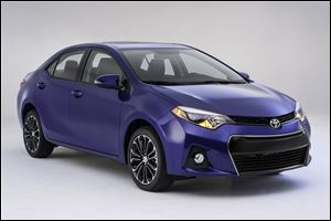 Toyota's new Corolla, revealed Thursday in Santa Monica, Calif., is aimed at shedding a low-cost image and attracting new, younger buyers.