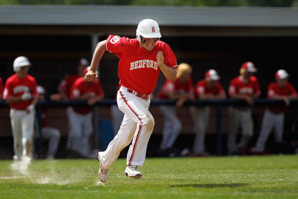 Bedford-senior-Jakob-Letson-sprints-to-first-but-is-forced-out-against-Belleville