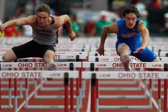 Patrick-Henry-s-Zach-Nye-right-competes-in-the-110-meter-hurdles