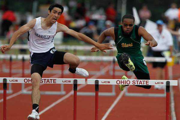 Start-s-Dionte-Carey-competes-in-the-300-meter-hurdles