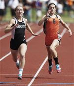 Gibsonburg-s-Colleen-Reynolds-right-won-the-400-meters-and