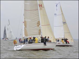 Boats in the PHRF G&H class cross the start line.