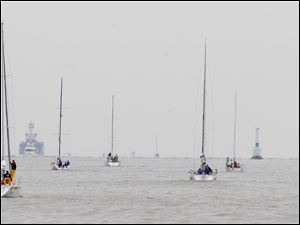 Racers head to the start of the Mills Trophy Race on Lake Erie.