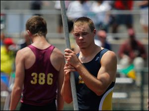 Toledo Whitmer's Nick Holley waits for his turn in the pole vault during  He didn't make the first two attempts, and he ended up not making his third.