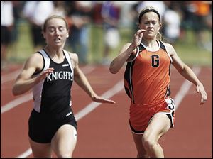 Gibsonburg's Colleen Reynolds, right, won the 400 meters and placed fifth in the 100 and 200 meters.