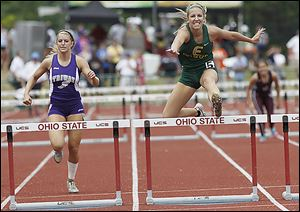 Evergreen's Carly Truckor wins the 300-meter hurdles.