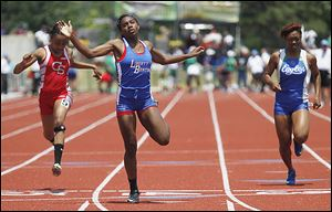 Liberty-Benton's Michaela Butler, center, won the 200-meter dash and came in second in the 100 meters.