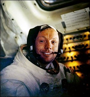 Neil Armstrong, shown in July 20, 1969, the first man on the moon, has never had a NASA facility named after him, but some in Congress want to change that.