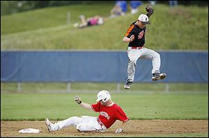 Bedford senior Jonathan Shepherd slides safely into second as Belleville junior Anthony Kovach jumps to make a catch.