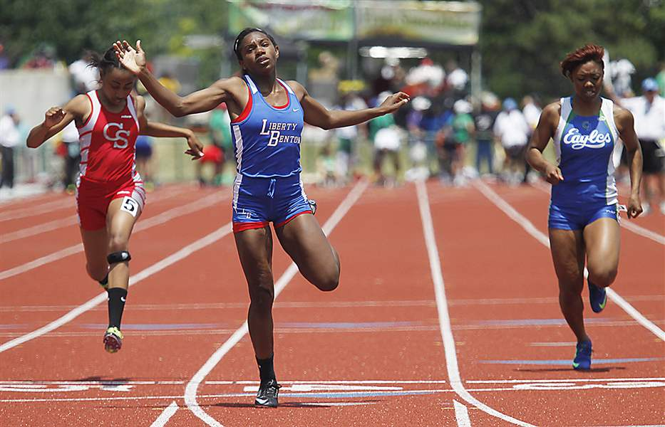 Liberty-Benton-s-Michaela-Butler-center-won-the-200-meter-dash