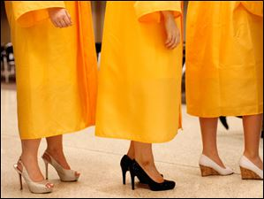 Graduates wore many different styles of shoes.