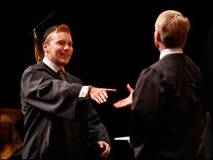 Northview graduate Julius Swolsky smiles as he receives his diploma.
