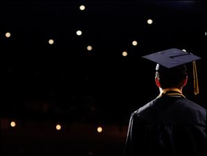 A Northview graduate waits to receive his diploma.