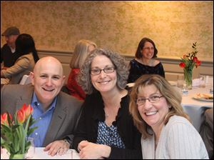 Nancy Goldberg, center, is flanked by Steve and Cheryl Rothschild at the benefit dinner for the American Heart Association