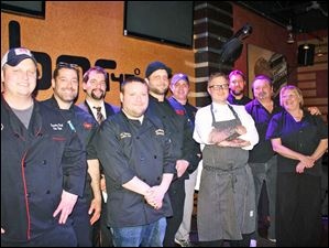 Chefs up for bid were, from left:  Chef Eric Kish, Rosie's - Chef Matt Lawrence, Mancy's Italian - Mark Maruszak,  Elements 112 - Chef Daniel Tankoos, Sundown Cantina - Chef Tim Childers, Rockwell's - Chef Brett McIntosh, Treo - Chef Robby Lucas, Bar 145 - Chef Rob Campbell, Revolution - Chef Bruce and Tracy Saba, Sabo's Bistro 1705. Bidding netted $17,900.