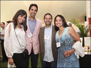 Resha and Prak Naik, Mandar and Muna Joshi enjoyed the food at Maumee Valley Country Day School's Top Chef fund-raiser.