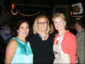 Co-chairnen of ProMedica Flower Hospital Auxillary's Shaken or Stirred? event were, from left, Beth Carr, Diane Dooley and Barbara Baumgartner.