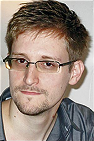 Edward Snowden has flown to Hong Kong and says he is worried for family and friends.