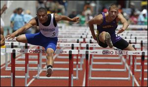 Bryan's Brandon Poncsak, right, competes in the 110 meter hurdles.