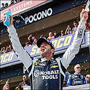 Jimmie Johnson takes the checkered flag to win the Pocono 400. Johnson led 128 of 160 laps in the race to continue to stretch his lead in the Sprint Cup standings.