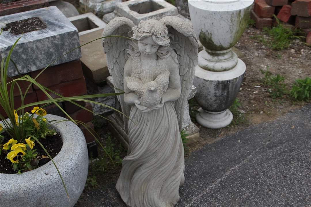 Cemetery-stealing-stolen-angel
